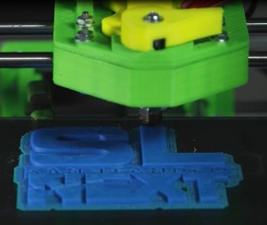A 3D printer at Omnom Project prints out the San Leandro Next logo.