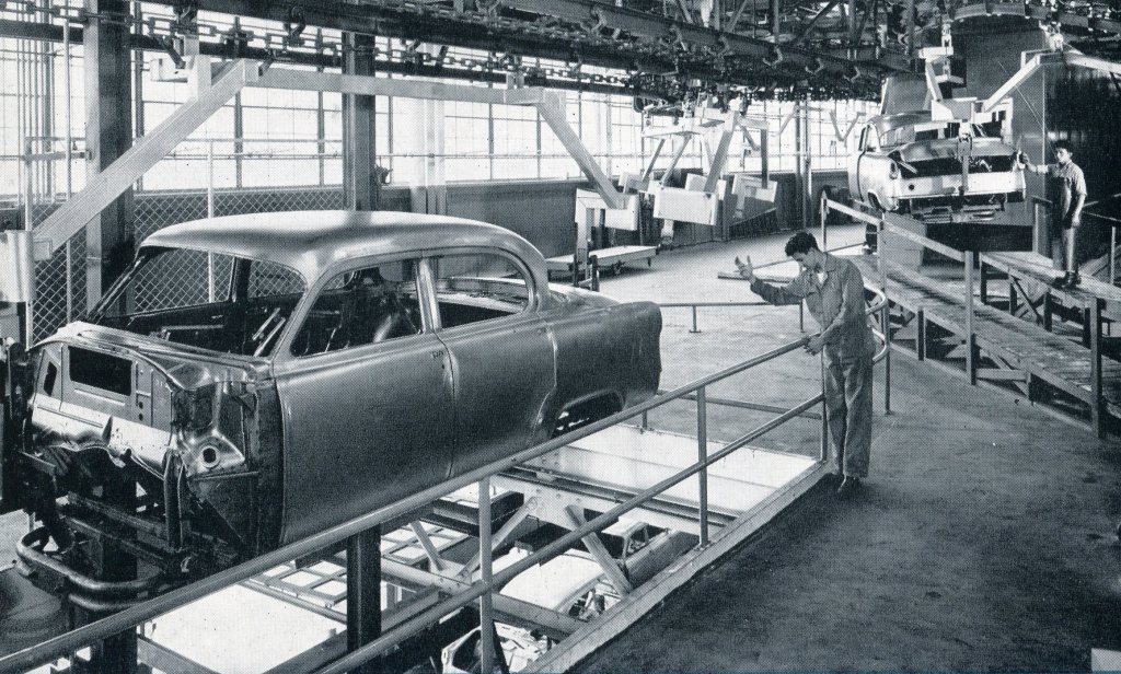 Assembly line in the Dodge Chrysler Auto Plant.  The windows are recognizable today.