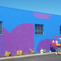 Kelly Ording's mural in progress at 14995 Farnsworth Ave.